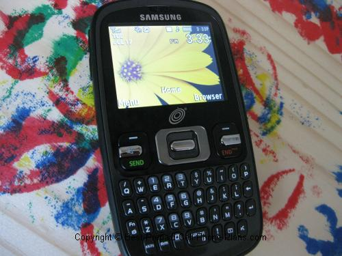 Samsung R355c with flower wallpaper graphic